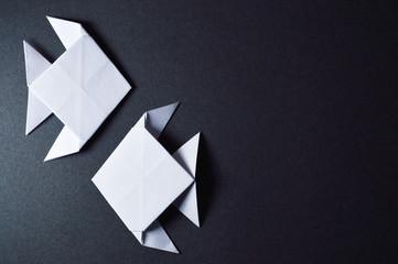 origami fishes on dark background