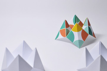 three origami fortune tellers on white background