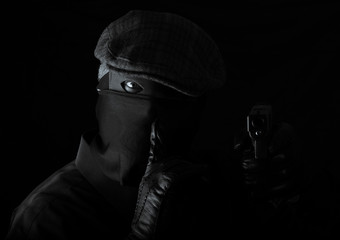 armed robber in black and white