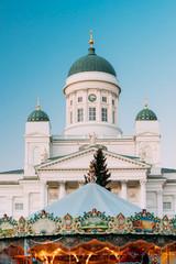 Helsinki, Finland. Xmas Market On Senate Square With Holiday Carousel