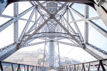 View from below on the famous Luis iron bridge during the morning light in Porto, Portugal
