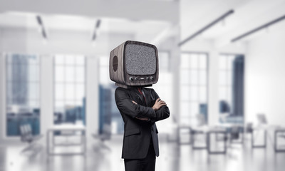Businessman with old TV instead of head.