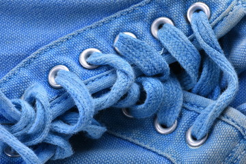 Old blue sneakers close-up