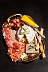 Food tray with charcuterie assortment and cheese