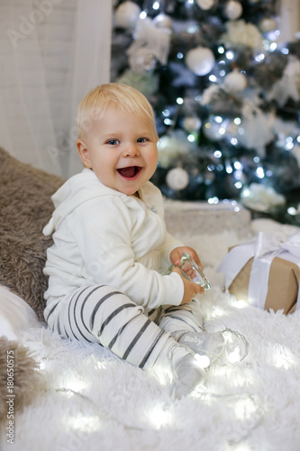 Cute 1 Year Old Baby Boy In Cozy Clothes Posing In New Year