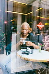 Blonde hair woman enjoying a coffee