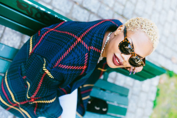 Blonde hair woman wearing sunglasses
