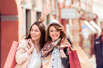 Young trendy women shopping in the city.