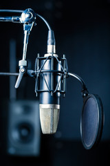 Professional microphone with capacitor or condenser in recording studio