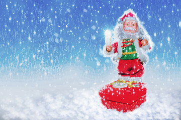 Santa standing on the snow.