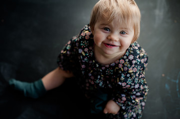 blonde baby girl laughing and looking up