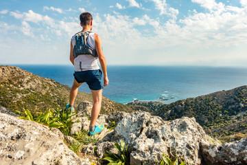 Trail runner looking at inspiring landscape