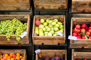 Fruits on rustic wooden boxes for sale on a street market