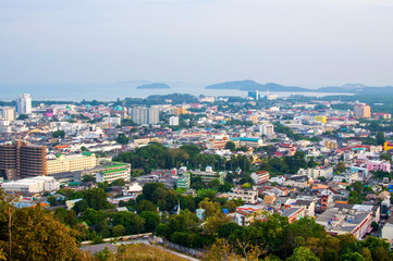 This is a panoramic view on the mountain viewpoint. See the city and the sea in the distance.