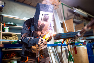 Welder working in workshop