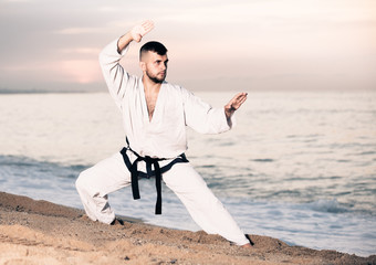 Adult man is training the Kokutsu-dachi stance