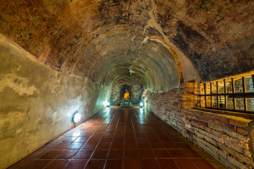Buddha statue in the old cave of Wat Umong Suan Puthatham Temple in Chiang Mai province, Thailand. 700 year ancient.