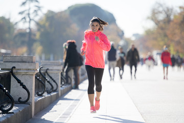 happy runner woman in Autumn or Winter sportswear running and tr