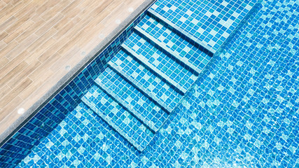 swimming pool with blue mosaic with stair step view from top