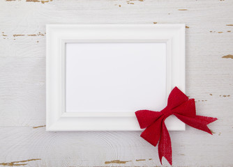 Customizable Picture Frame with Red Christmas Bows on a White Wood Table