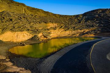 Volcanic green lake (El Lago Verde, Charco de los Clicos) in El Golfo. Lanzarote. Canary Islands. Spain