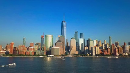 Fototapete - Pullback reveal video: Aerial cityscape view of New York City, One World Trade Center and Lower Manhattan