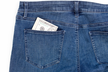 American dollar banknote in a pocket of blue jean