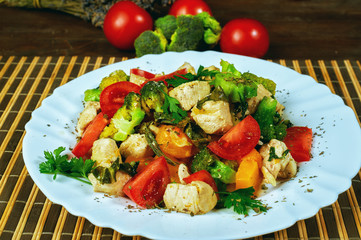 Warm salad with pumpkin , chicken and vegetable