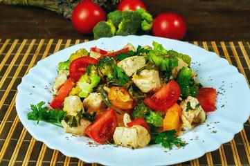 Warm salad with pumpkin , chicken and vegetable