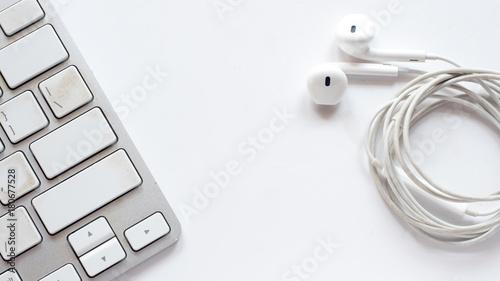 Wall mural keyboard topview with earphone