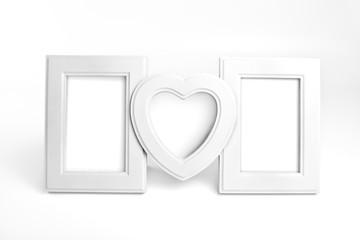 White wooden photo frame of family.