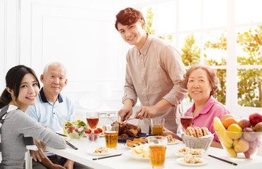 Happy asian family having dinner together.