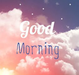 Good morning word letter on pink and blue pastel sky and white stars.