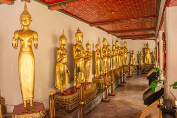 Standing Buddha image at Wat Pho that is a Buddhist temple complex Chinese and Thai style in Bangkok, Thailand