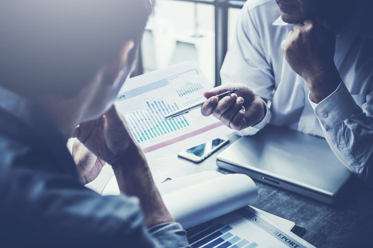 Discussing plan and idea to improvement strategy, businessmen brainstorming for strategy of business investment,businessmen review chart and document of investment information