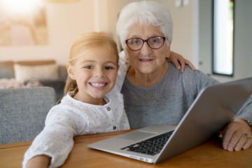 Portrait of smiling little girl with grandmother