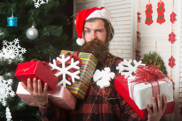 Christmas man with beard on face hold gift.