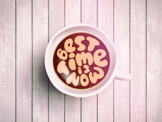Coffee cup with time lettering about best time is now on realistic wooden background. Cappuccino from above with motivation quote. Top view of espresso cup with morning motivation.