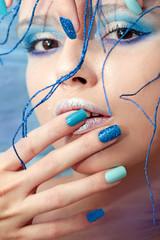 Wall Mural - Разноцветный синий маникюр и макияж.