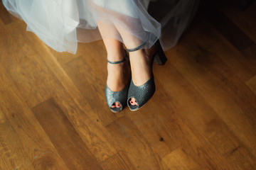 bride's feet in shoes