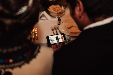 groom watching at his phone