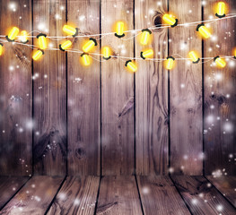 Garland with lights. Old wooden background. Celebratory lights. Night party.