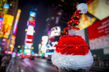 Santa hat with colorful Christmas lights in Times Square, New York City