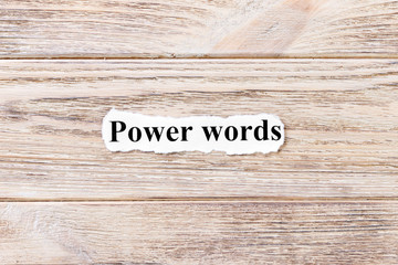 power of words of the word on paper. concept. Words of power of words on a wooden background
