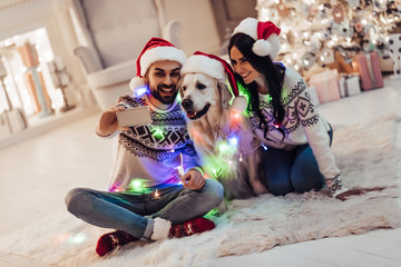Couple with dog on New Year's Eve