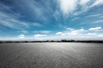 empty asphalt road with snow mountains in blue cloud sky