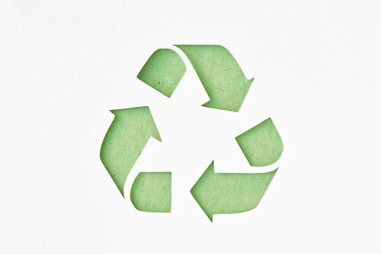 Recyclig symbol on recycled paper