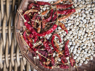 Dry Chili and Garlic Asian herb food ingredient in Basket