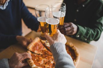 friends clinking glasses of beer