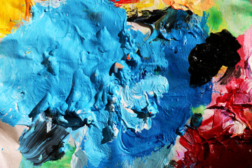 Abstract art background. Pigment acrylic colors on palette.